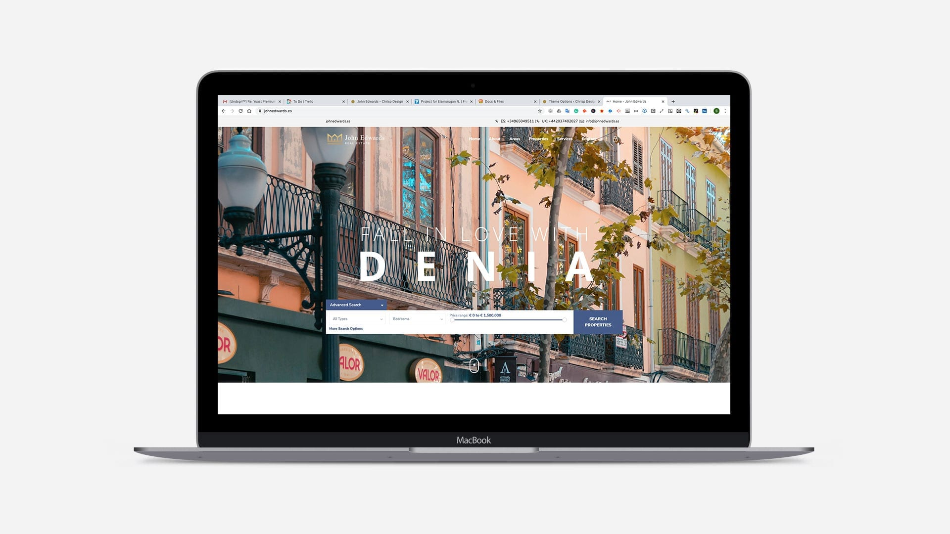 macbook view of website denia